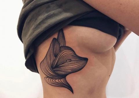 Lis damski tatuaż