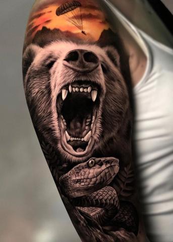 Tatuaż niedżwiedź na ręce