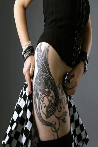 Damski tatuaż smok