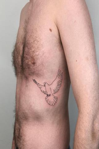 Tatuaż gołąb dla mężczyzny