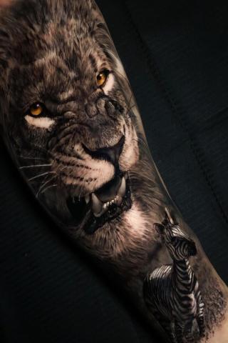 Tatuaż lew i zebra